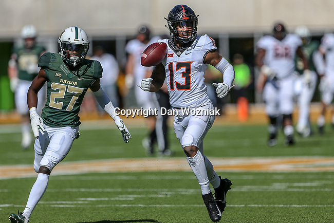 Oklahoma State Cowboys wide receiver Tyron Johnson (13) in action during the game between the OSU Cowboys and the Baylor Bears at the McLane Stadium in Waco, Texas.