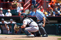 Altoona Curve catcher Reese McGuire (7) and umpire Chris Graham await a pitch during a game against the Erie SeaWolves on July 10, 2016 at Jerry Uht Park in Erie, Pennsylvania.  Altoona defeated Erie 7-3.  (Mike Janes/Four Seam Images)