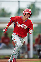 GCL Phillies center fielder Mickey Moniak (15) runs to first base during a game against the GCL Pirates on August 6, 2016 at Pirate City in Bradenton, Florida.  GCL Phillies defeated the GCL Pirates 4-1.  (Mike Janes/Four Seam Images)