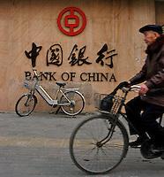 A cyclist passes the Bank of China in Zhengzhou, China..