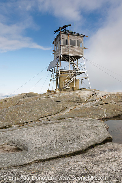 Mount Cardigan State Park - Cardigan Mountain Tower on the summit of Cardigan Mountain in Orange, New Hampshire. This fire tower was put into operation in 1924 and it is still in use today. Fire burned over the summit in 1855, and it is the reason why the summit of this mountain is bald.