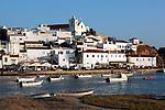 Portugal, Algarve, near Portimao: View across river Arade to the traditional white fishing village Ferragudo