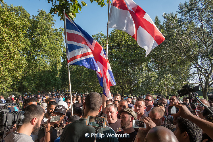 Young Muslim men argue with English nationalists, Speakers' Corner, Hyde Park, London.