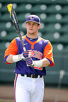Catcher Chris Okey (25) of the Clemson Tigers prior to the Reedy River Rivalry game against the South Carolina Gamecocks on Saturday, February 28, 2015, at Fluor Field at the West End in Greenville, South Carolina. South Carolina won, 4-1. (Tom Priddy/Four Seam Images)