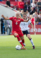 02 June 2013: U.S. Women's National Team midfielder Heather O'Reilly #9 and Canadian Women's Team Player Kaylyn Kyle #6 in action during an International Friendly soccer match between the U.S. Women's National Soccer Team and the Canadian Women's National Soccer Team at BMO Field in Toronto, Ontario.<br /> The U.S. Women's National Team Won 3-0.