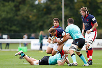 Charlie Ingall of London Scottish is tackled during the Championship Cup match between London Scottish Football Club and Nottingham Rugby at Richmond Athletic Ground, Richmond, United Kingdom on 28 September 2019. Photo by Carlton Myrie / PRiME Media Images