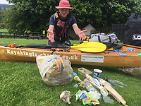 BNPS.co.uk (01202) 558833. <br /> Video: RoyBeal/KayakingForCharity/BNPS<br /> <br /> With Video - Download: https://we.tl/t-oBNxF4nwZe<br /> <br /> Pictured: Roy with plastic he collected on the journey. <br /> <br /> Potty paddler Roy Beal has written himself into the record books by kayaking from John O'Groats to Land's End – through canals, rivers and the sea.<br /> <br /> Roy embarked on the 900 mile odyssey that lasted 56 days in his wooden kayak named 'Just Add Water' and averaged around 20 miles a day.<br /> <br /> He paddled down the north east coast of Scotland, through Loch Ness and Loch Oich, down the west coast of Scotland and England to Merseyside where he ventured inland through canals and rivers before coming out through the Severn Estuary at Bristol and then around the south west coast to Land's End.