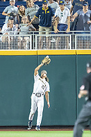 Michigan Wolverines outfielder Jordan Brewer (22) makes a catch against the Vanderbilt Commodores during Game 2 of the NCAA College World Series Finals on June 25, 2019 at TD Ameritrade Park in Omaha, Nebraska. Vanderbilt defeated Michigan 4-1. (Andrew Woolley/Four Seam Images)
