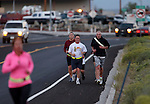 Col. Michael Hanifan, the incoming commander of the Nevada National Guard, in white, and Sgt. 1st Class Jeremy Mock, in black, were among approximately 50 people who participated in a memorial 5K walk and run in honor of the victims of the 2011 IHOP shooting in Carson City, Nev., on Friday, Sept. 6, 2013. Four people were killed and Mock was one of nine people injured when Eduardo Sencion opened fire in the restaurant before killing himself in the parking lot.   <br /> Photo by Cathleen Allison