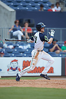 Drew Waters (11) of the Gwinnett Stripers follows through on his swing against the Scranton/Wilkes-Barre RailRiders at Coolray Field on August 18, 2019 in Lawrenceville, Georgia. The RailRiders defeated the Stripers 9-3. (Brian Westerholt/Four Seam Images)