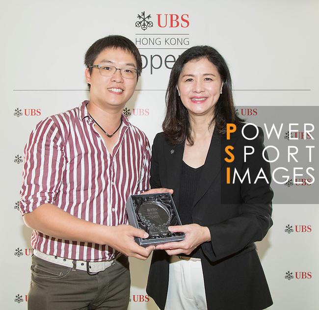 Winners get their prize out of the hands of UBS Hong Kong Country Head Amy Lo at the end of he Am-Am tournament of the 58th UBS Hong Kong Golf Open as part of the European Tour on 13 December 2016, at the Hong Kong Golf Club, Fanling, Hong Kong, China. Photo by Vivek Prakash / Power Sport Images