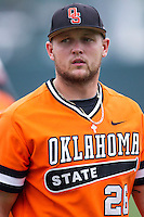 Oklahoma State Cowboys designated hitter Zach Fish #26 before the NCAA baseball game against the Texas Longhorns on April 26, 2014 at UFCU Disch–Falk Field in Austin, Texas. The Cowboys defeated the Longhorns 2-1. (Andrew Woolley/Four Seam Images)