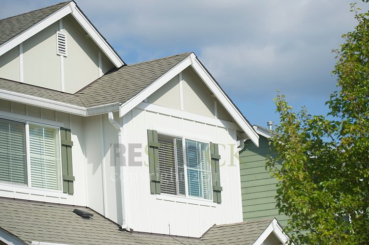 Second Story of White Home with Tree