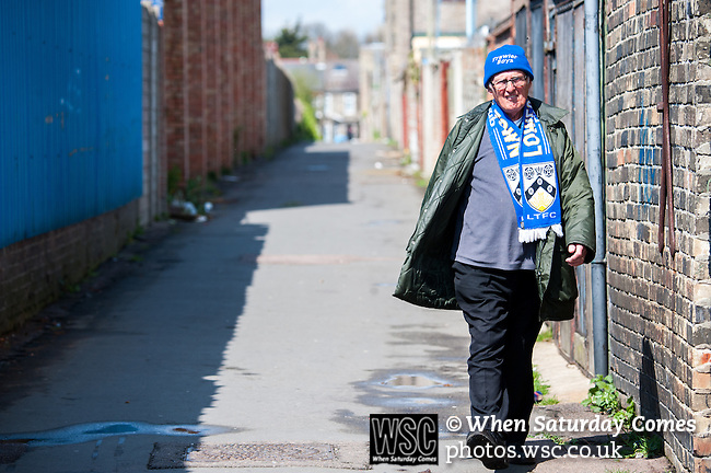 Lowestoft Town 2 Barrow 3, 25/04/2015. Crown Meadow, Conference North. Barrow make the six-hour trip to Suffolk needing a win to secure the title. A Lowestoft supporter on his way to the game. Photo by Simon Gill.