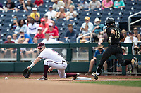Mississippi State Bulldogs first baseman Tanner Allen (5) reaches for a throw during Game 8 of the NCAA College World Series against the Vanderbilt Commodores on June 19, 2019 at TD Ameritrade Park in Omaha, Nebraska. Vanderbilt defeated Mississippi State 6-3. (Andrew Woolley/Four Seam Images)