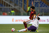 Calcio, Serie A: Roma vs Fiorentina. Roma, stadio Olimpico, 4 marzo 2016.<br /> Roma's Mohamed Salah, left, is tackled by Fiorentina's Davide Astori during the Italian Serie A football match between Roma and Fiorentina at Rome's Olympic stadium, 4 March 2016.<br /> UPDATE IMAGES PRESS/Riccardo De Luca