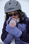 young Asian girl takes power drink, during pause from winter activity outdoors  at Copper Mountain Ski Resort, Copper Mountain, Colorado, USA, model released (MR), CJ, (MR), model released, #94