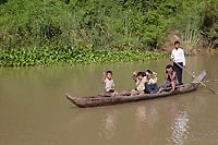 Mekong River<br /> , Cambodia - 2007 File Photo -<br /> <br /> children in boat waving.   <br /> <br /> <br /> <br /> photo : James Wong-  Images Distribution