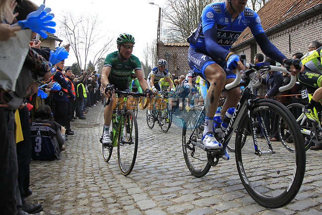 The peloton including Thomas Voeckler (FRA) Team Europcar climbs Molenberg during the 96th edition of The Tour of Flanders 2012, running 256.9km from Bruges to Oudenaarde, Belgium. 1st April 2012. <br /> (Photo by Eoin Clarke/NEWSFILE).