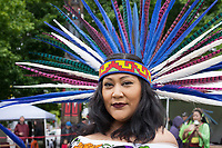 Native American woman wearing feather headdress, Northwest Folklife Festival 2016, Seattle Center, Washington, USA.