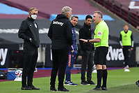 21st March 2021; London Stadium, London, England; English Premier League Football, West Ham United versus Arsenal; West Ham United Manager David Moyes is given a warning by referee Jonathan Moss