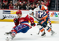 WASHINGTON, DC - JANUARY 31: Casey Cizikas #53 of the New York Islanders  maneuvers the puck around Nick Jensen #3 of the Washington Capitals during a game between New York Islanders and Washington Capitals at Capital One Arena on January 31, 2020 in Washington, DC.