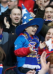 A young Rangers fan beaming with delight as his heroes take to the field