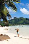 Seychelles, Island Mahe, Anse Boileau: woman at beach, west coast<br />