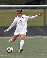 Harvard University midfielder Aisha Price (5) clears the ball. In overtime, Harvard University defeated Yale University,1-0, at Soldiers Field Soccer Stadium, on September 29, 2012.