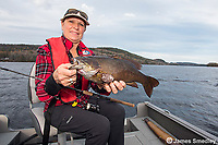 Female angler with bass