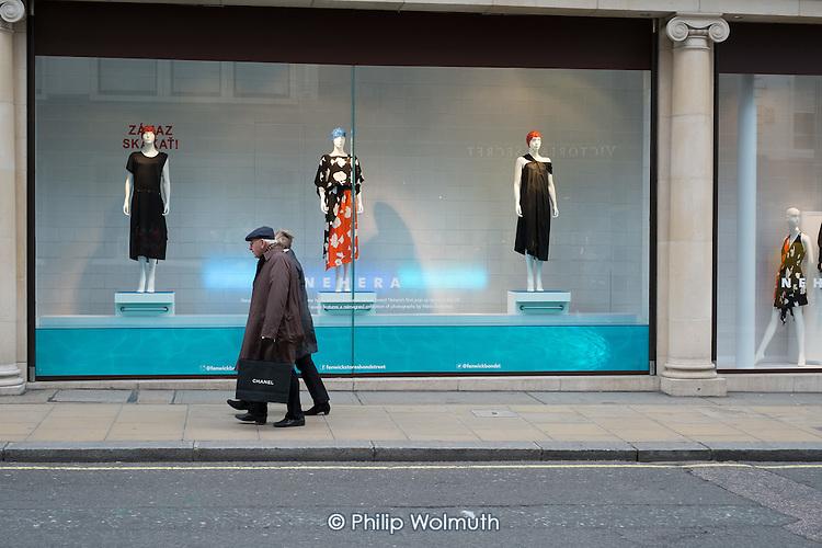 Pedestrians and window display in Fenwick store Bond Street Mayfair, London.