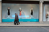 Pedestrians and window display in Fenwick store Bond Street Mayfair, London.