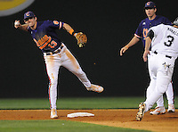Shortstop Brad Miller (13) of the Clemson Tigers gets a force out on Adrian Morales to start a double play in the second inning of a game against the South Carolina Gamecocks on Tuesday, March 8, 2011, at Fluor Field in Greenville, S.C.  Photo by Tom Priddy / Four Seam Images