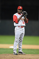 Brooklyn Cyclones pitcher Carlos Valdez (16) gets ready to deliver a pitch during a game against the Batavia Muckdogs on August 11, 2014 at Dwyer Stadium in Batavia, New York.  Batavia defeated Brooklyn 4-3.  (Mike Janes/Four Seam Images)