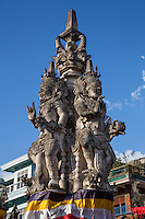 Bali, Indonesia.   Kanda Pat Sari Statue, Guardian of the Four Directions, in a Traffic Roundabout.  Klungkung, Semarapura.