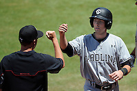 Second baseman DC Arendas (7) of the South Carolina Gamecocks is congratulated after scoring a run in an NCAA Division I Baseball Regional Tournament game against the Campbell Camels on Sunday, June 1, 2014, at Carolina Stadium in Columbia, South Carolina. (Tom Priddy/Four Seam Images)