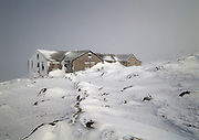 Lakes of the Clouds Hut, along the Appalachian Trail (Crawford Path),  in whiteout conditions in the White Mountains of New Hampshire. On a clear day, Mount Washington can be seen in the background.