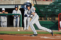 West Michigan Whitecaps center fielder Danny Woodrow (8) bunts during a game against the Burlington Bees at Community Field on May 11, 2017 in Burlington, Iowa.  The Whitecaps won 10-3.  (Dennis Hubbard/Four Seam Images)