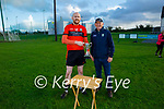 Damien Casey, Ballyheigue captain accepts the 2020 Junior hurling championship cup from Paudie Dineen, Hurling Officer of the Kerry County Committee after defeating Duagh.