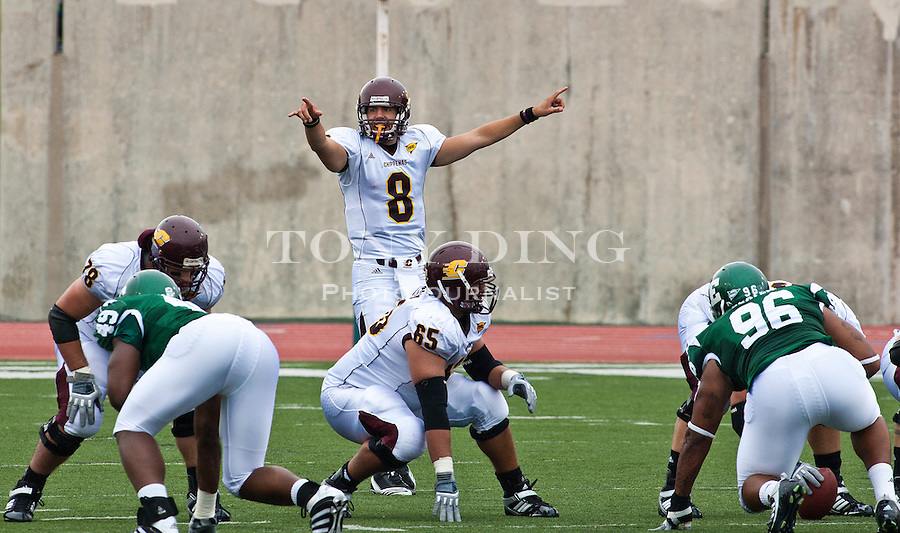 Central Michigan quarterback Ryan Radcliff (8) calls off defensive coverages to his linemen in the first quarter of an NCAA college football game with Eastern Michigan, Saturday, Sept. 18, 2010, in Ypsilanti, Mich. (AP Photo/Tony Ding)