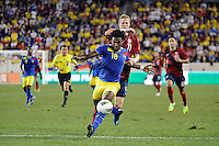 Gabriel Achilier (18) of Ecuador shields the ball from Brek Shea (11) of the United States. The men's national team of the United States (USA) was defeated by Ecuador (ECU) 1-0 during an international friendly at Red Bull Arena in Harrison, NJ, on October 11, 2011.