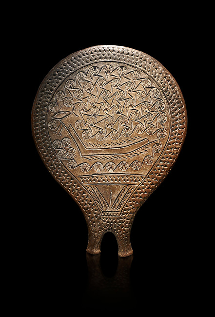 Cycladic terracotta 'frying pan' with incied boat and spiral decoration from Chalandriani, Syros. Early Cycladic period II 2800-2300 BC), National Archaeological Museum Athens, Cat No 4974. Black background.<br /> <br /> Yje incised decorations depict a boat amongst spiral formed waves. The boats is of a Ctcladic design  found throughout the Aegean.<br /> <br /> These so called 'frying pans' wre created by the Keros-Syros culture and are their useage is uncertain. The compex geometric patterns on their bases suggest that they may have had some symbolic meaning and were used in religious of magical rituals. They could also have served practical purposes being used as dishes, mirror mounts, astrolabes or metris measured for salt traders.
