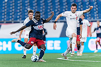 FOXBOROUGH, MA - JULY 9: Edward Kizza #19 of New England Revolution II takes a shot during a game between Toronto FC II and New England Revolution II at Gillette Stadium on July 9, 2021 in Foxborough, Massachusetts.
