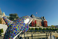 Symbolic colorful tiled dolphin statue in Victoria City harbour, East Pacific ocean, south of Vancouver Island, British Columbia, Canada, North America