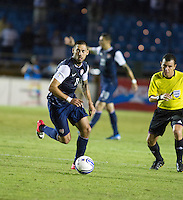 Clint Dempsey dribbles the ball as the United States played Guatemala at Estadio Mateo Flores in Guatemala City, Guatemala in a World Cup Qualifier on Tue. June 12, 2012.