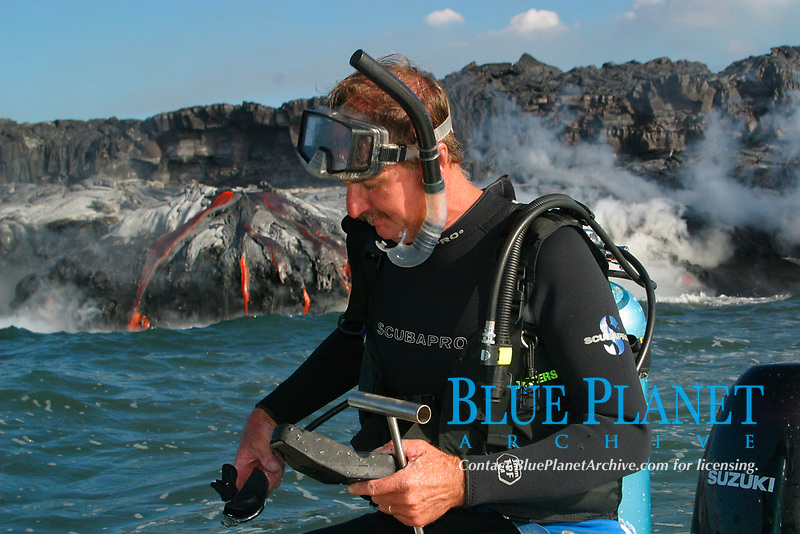 diver and underwater lava sculptor Bud Turpin prepares to enter the water as hot lava from Kilauea Volcano pours into the Pacific Ocean at Hawaii Volcanoes National Park, Big Island (Hawaii Island) Hawaiian Islands, USA, Pacific Ocean, MR