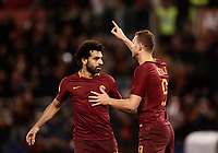 Calcio, Serie A: Roma, stadio Olimpico, 19 marzo, 2017<br /> Roma's Edin Dzeko (r) celebrates with his teammates Mohamed Salah (l) after scoring during the Italian Serie A football match between Roma and Sassuolo at Rome's Olympic stadium, March 19, 2017<br /> UPDATE IMAGES PRESS/Isabella Bonotto