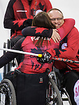 Sochi, RUSSIA - Mar 8 2014 -  Ina Forrest and Dennis Thiessen celebrates their victory over Russia during round robin play in Wheelchair Curling during the 2014 Paralympic Winter Games in Sochi, Russia.  (Photo: Matthew Murnaghan/Canadian Paralympic Committee)