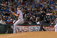 AFL East third baseman Bobby Dalbec (11), of the Mesa Solar Sox and Boston Red Sox organization, prepares to make a throw to first base in front of third base umpire Brennan Miller during the Arizona Fall League Fall Stars game at Surprise Stadium on November 3, 2018 in Surprise, Arizona. The AFL West defeated the AFL East 7-6 . (Zachary Lucy/Four Seam Images)