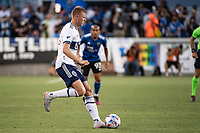 SAN JOSE, CA - AUGUST 13: Andy Rose #15 of the Vancouver Whitecaps dribbles the ball during a game between San Jose Earthquakes and Vancouver Whitecaps at PayPal Park on August 13, 2021 in San Jose, California.